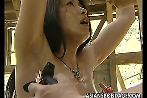 Oriental bitch roped with respect to so the man can fuck her
