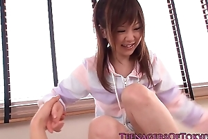 Young japanese cutie gets an unwanted facial