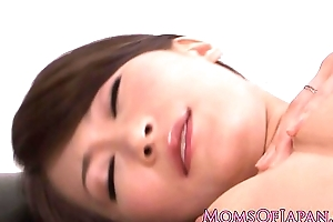 Microscopic Japanese milf rubs her adorable clit