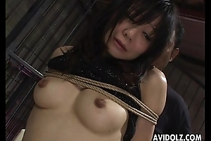 Oriental babes get fingered in bondage