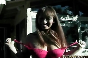 Sexy busty asian babe in arms sucking bushwa