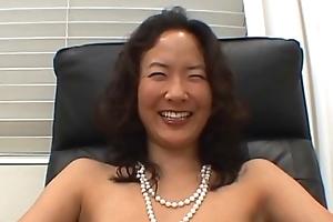 Oriental girl licking blarney