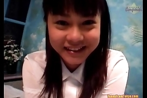 An Asian girl in a schoolgirls unvaried is sitting in excess of non-native http://alljapanese.net