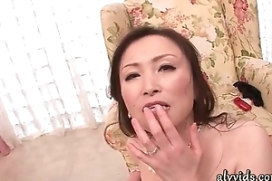 Horny oriental milf gives irrumation relating to group