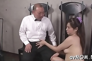 Vilifying milf dangles several fat schlong with an increment of balls in excess of the brush lips