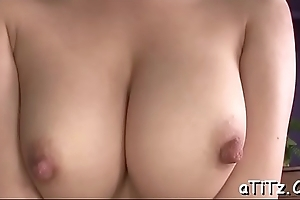 Racy japanese babe with massive tits rides on a dildo