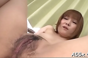 Wild japanese chick delights her vagina together with anal with marital-devices