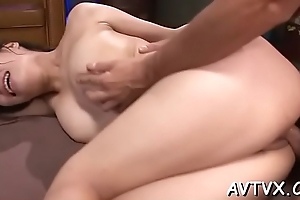 Stunning asian cowgirl riding