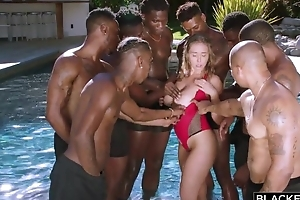 Insatiable nympho all over heavy unpractised tits enjoys interracial gangbang
