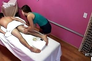 Asian masseuse massaging customers dick
