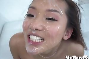 Gonzo oriental receives bukkake facial