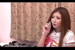 Horny Japanese teen fingers her cum-hole